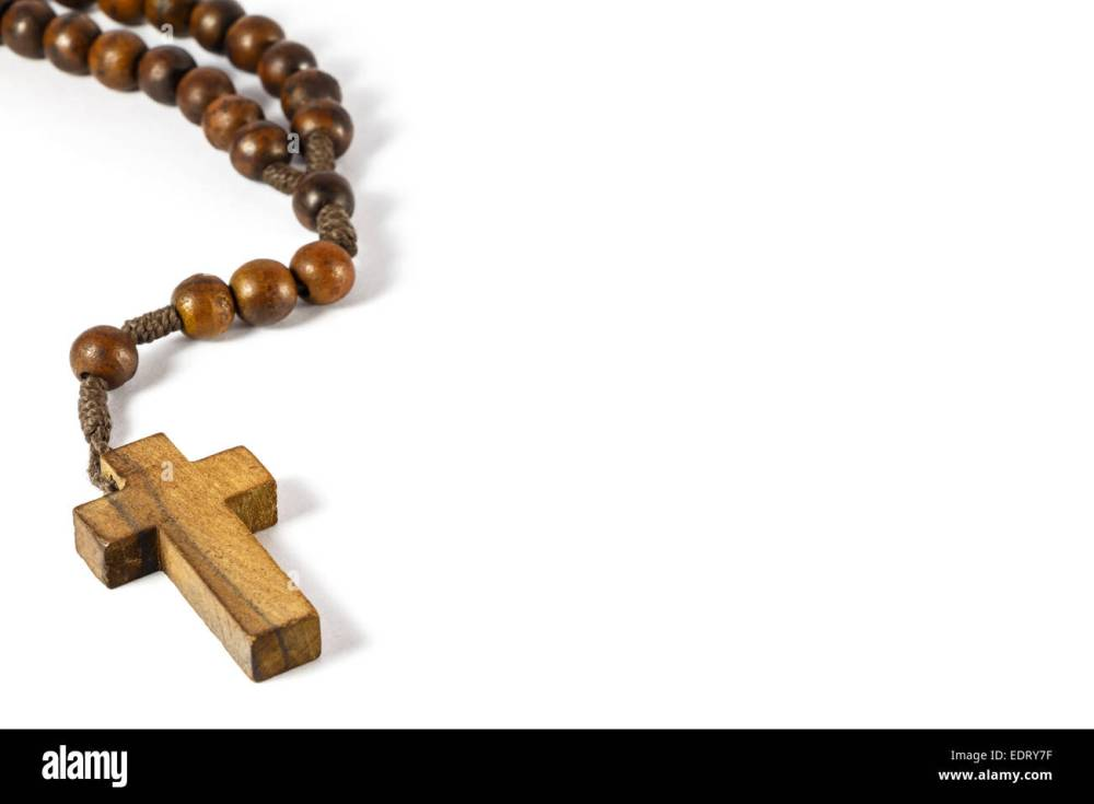 medium resolution of wood rosary with cross at left border and blank area at right side white background