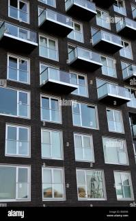 Windows and balconies on modern high rise apartment ...