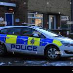 Police Cars In The Snow Vauxhall Mg And Fords Outside Small Local Stock Photo Alamy