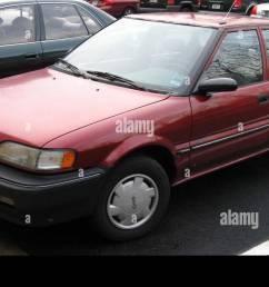 geo prizm hatchback stock image [ 1300 x 809 Pixel ]
