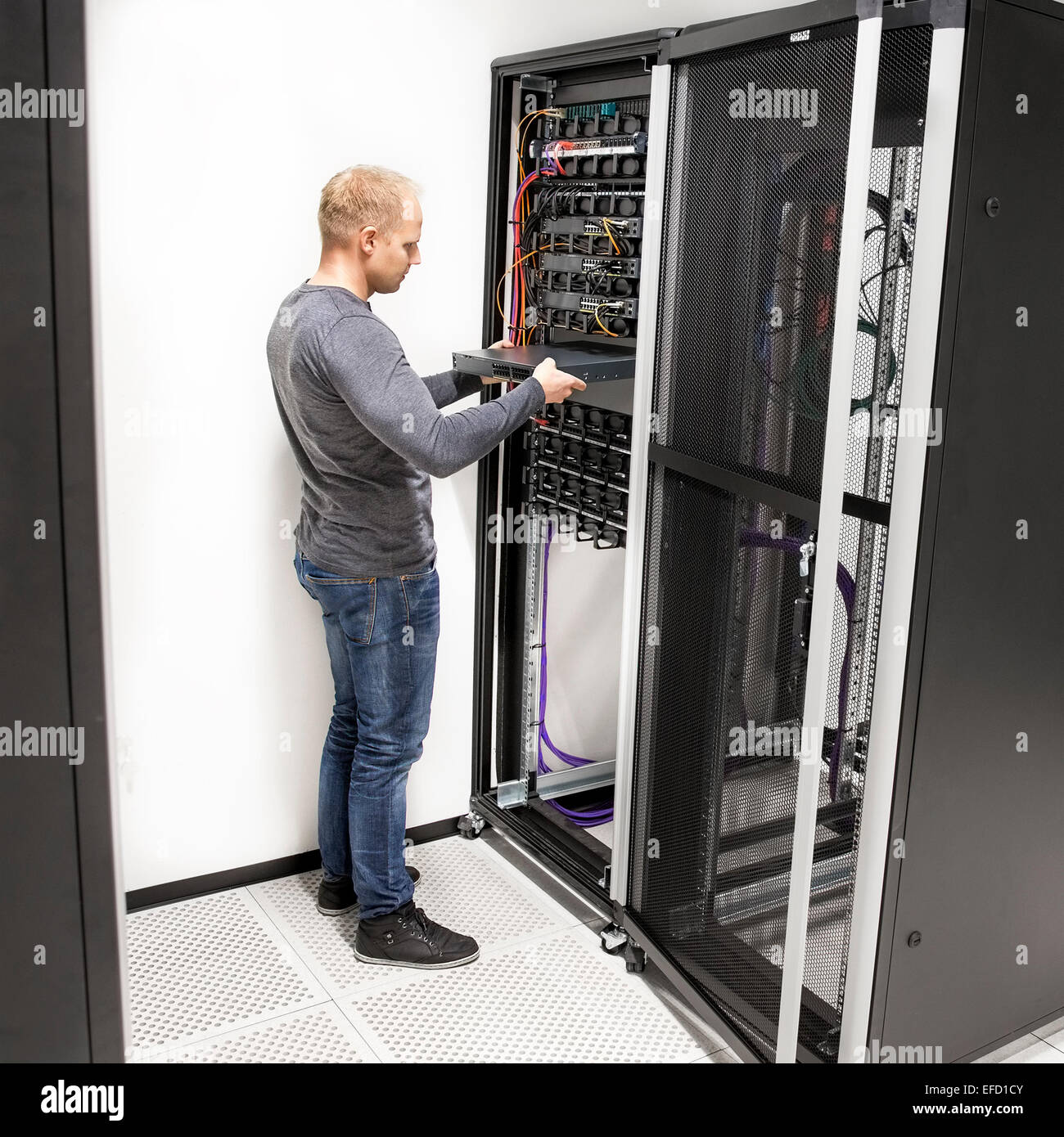 hight resolution of it technician install network rack in datacenter