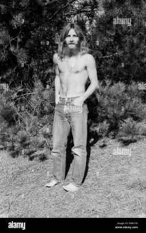 Portrait Of Hippie Man With Beard And Long Hair Standing