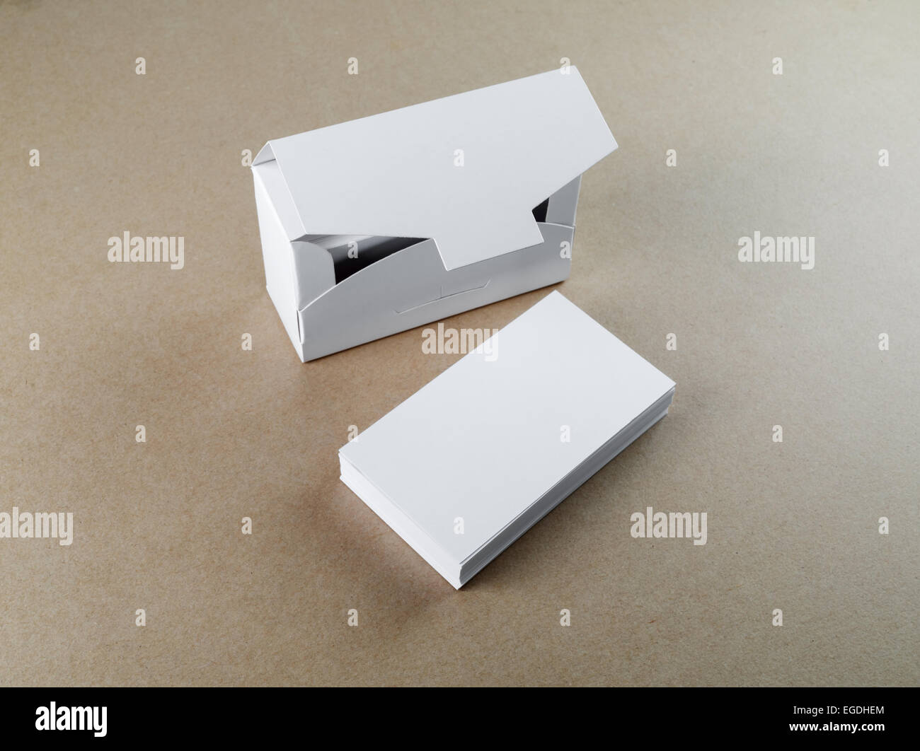 Blank business cards and a box for them on the table. Template for ...