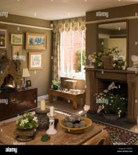 Brown living room with wooden fireplace in UK home Stock ...