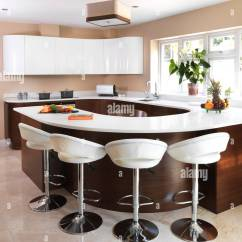 Kitchen Bar Stools Brushed Nickel Pendant Lighting At Breakfast In Modern Uk Home Stock Photo