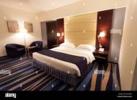 Modern hotel room with king size bed Stock Photo, Royalty ...