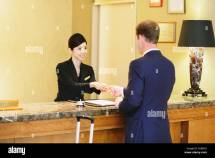 Japanese Female Hotel Concierge Dealing With Customer