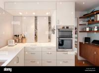 Modern kitchen with white units in apartment in Highpoint