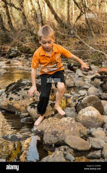 Barefoot Boy Climbing Rocks