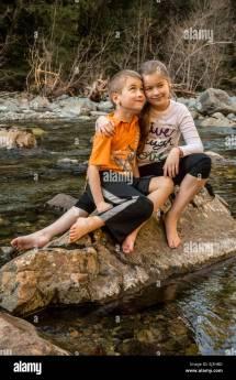 Nine Year Girl Giving Seven Brother Hug