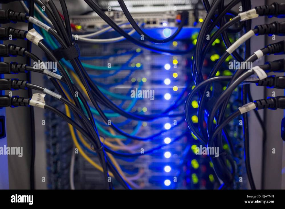 medium resolution of interior of server with wires blue stock image