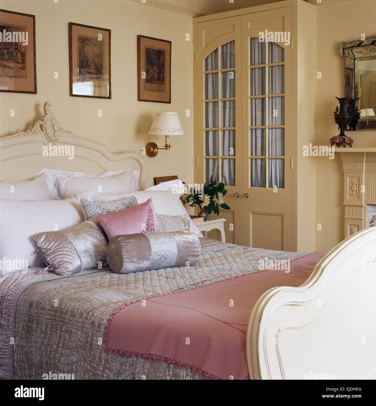 https www alamy com stock photo satin and silk bolster cushions with pink throw on painted bed in 80204532 html