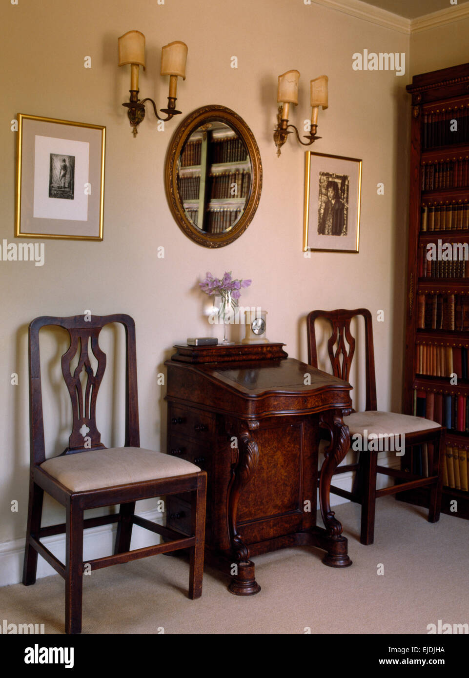 small dining chairs custom barber on either side of antique desk in old fashioned study