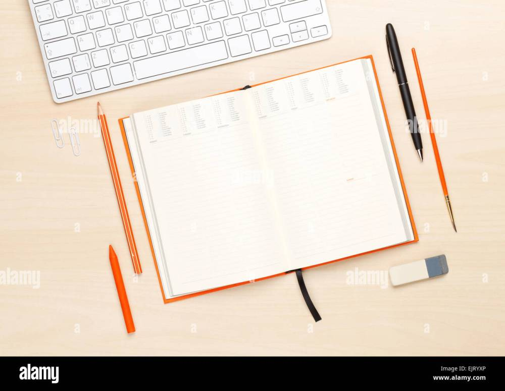 medium resolution of office table with blank notepad and supplies top view with copy space