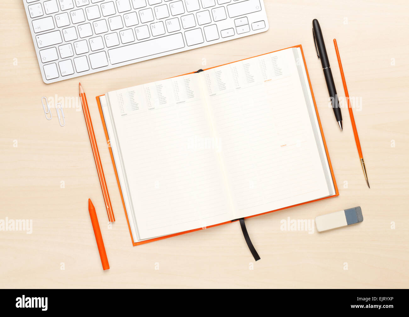 hight resolution of office table with blank notepad and supplies top view with copy space