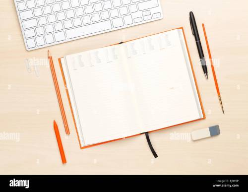 small resolution of office table with blank notepad and supplies top view with copy space