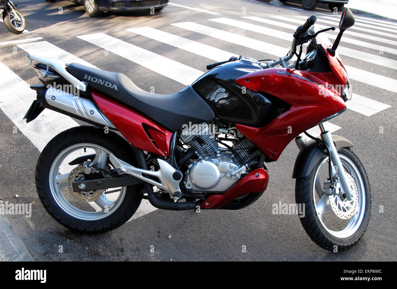 hight resolution of honda varadero 125 parked in front of a pedestrian crossing stock image