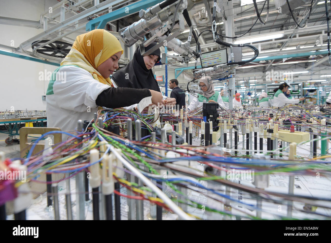 hight resolution of tunisian employees work on a wiring harness