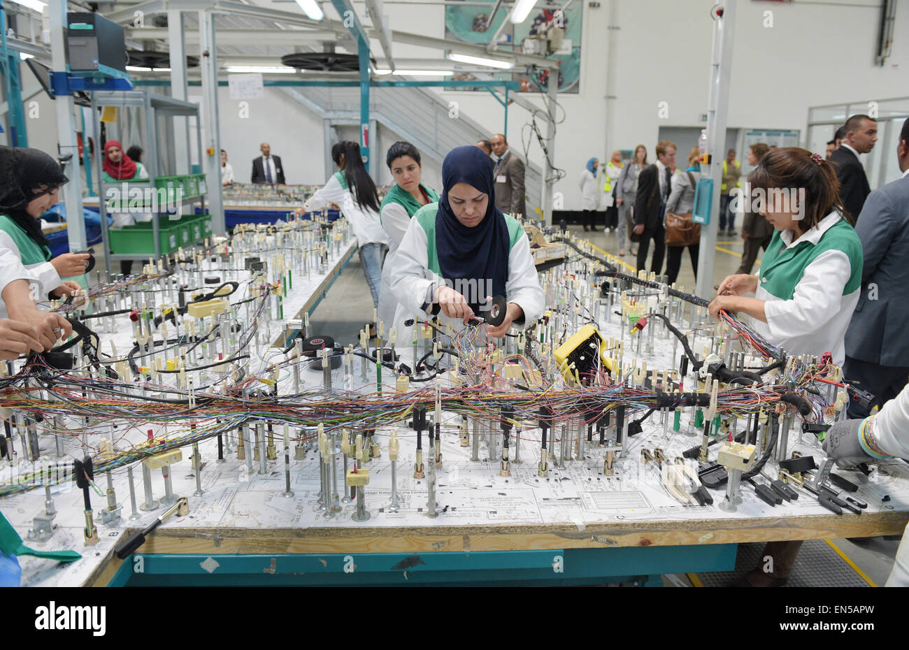 hight resolution of tunisian employees work on a wiring harness for vehicles in the factory of the german car parts supplier draexlmeier in siliana tunisia 28 april 2015