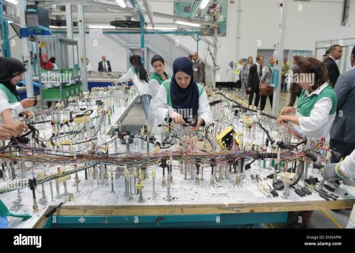 small resolution of tunisian employees work on a wiring harness for vehicles in the factory of the german car parts supplier draexlmeier in siliana tunisia 28 april 2015