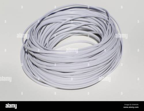 small resolution of white phone cord to switch on a white background stock image