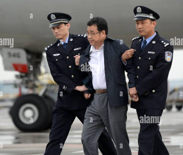 Chinese Police Escort Li Huabo C The Second Suspect From Chinas 100 Most Wanted Economic Fugitives List Upon His Arrival At The Beijing Capital