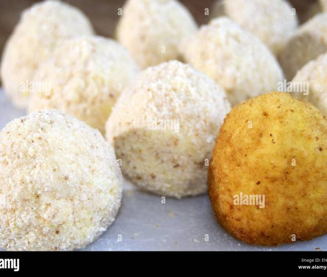 Raw Arancini A Rice Croquette Stuffed With A Sauce Of Minced Meat Tomato And Peas