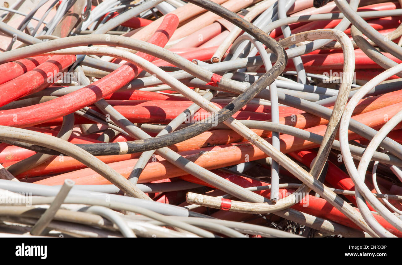 hight resolution of red electrical wires and other lengths of copper wire in the dump of special material