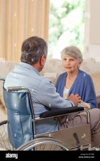 Senior couple talking in the living room at home Stock