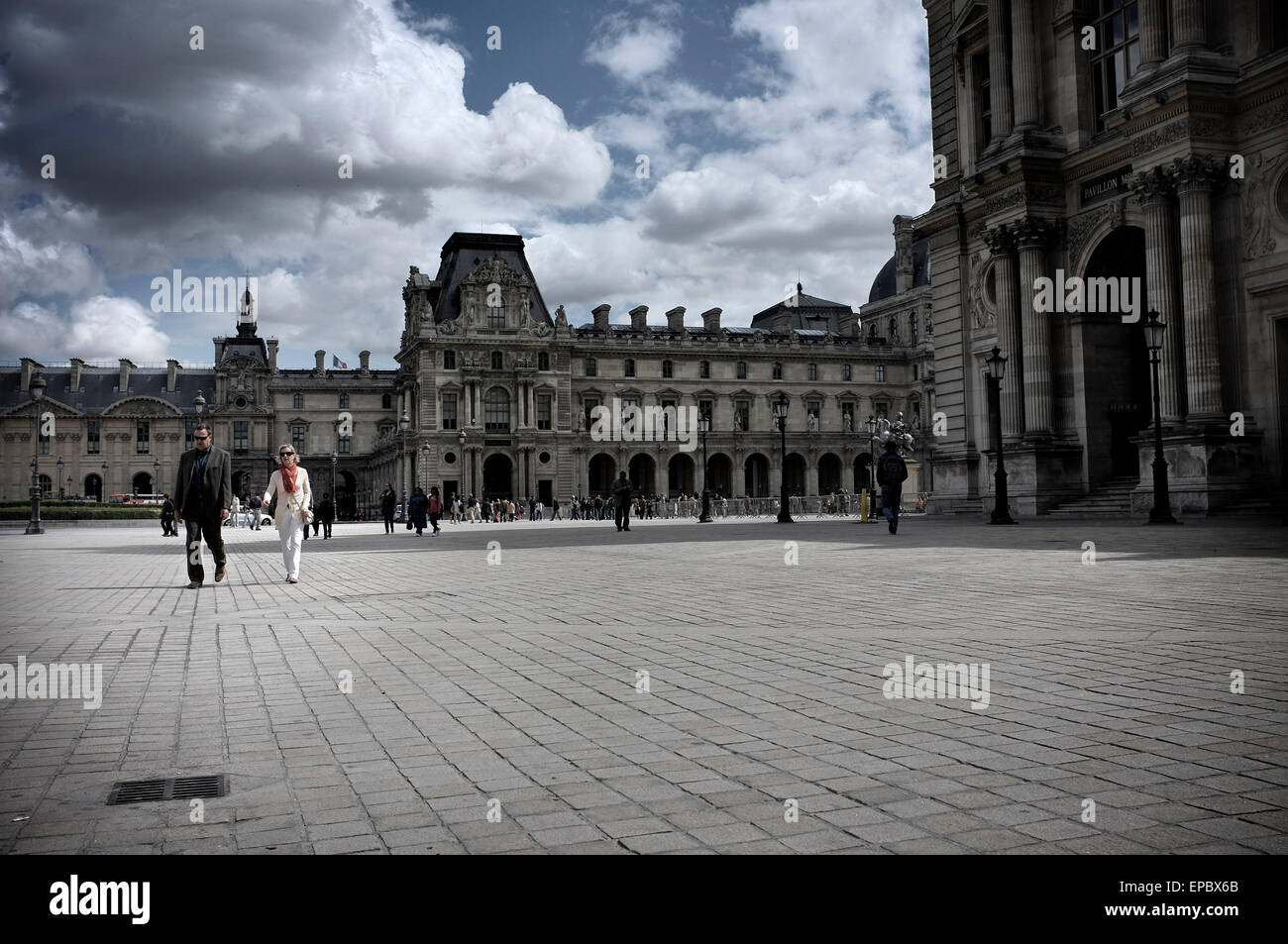 Couple Walking In The Louvre Museum S Courtyard Paris