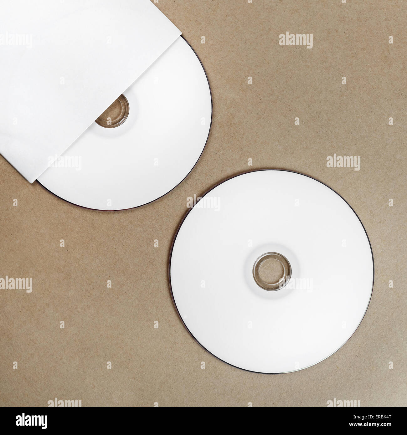 Photo Of Blank Compact Disk On A Table. Template For Branding Identity For  Designers. Top View.