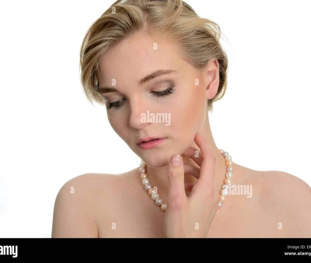 Model With Soft Face Expression Kind Girl Wears Pearl On Her Neck One Hand Near Face