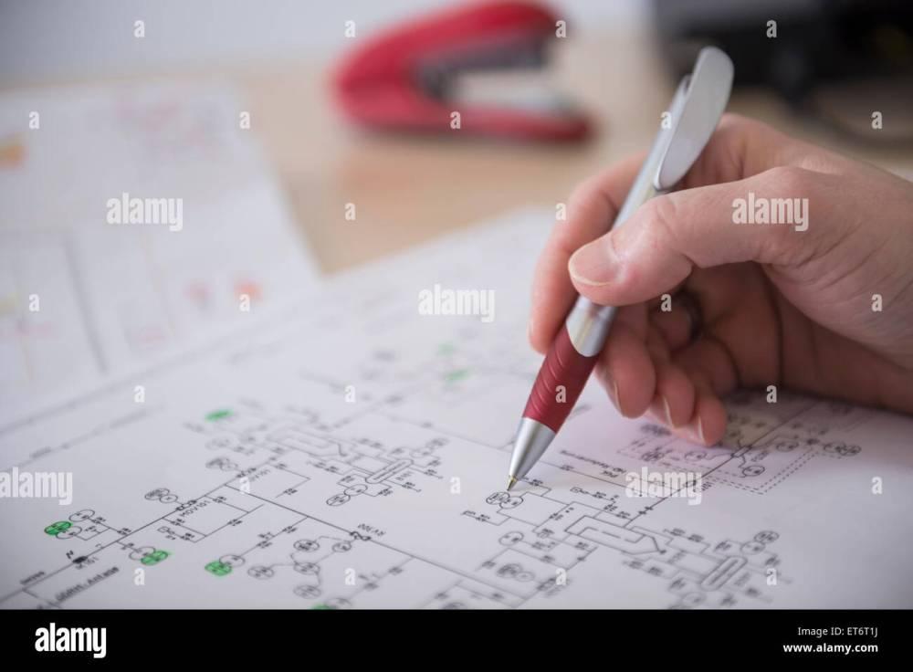 medium resolution of engineer analysing wiring diagram munich bavaria germany