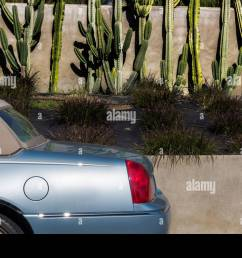 classic rag top lincoln town car viewed from left rear again wall and cactus [ 1300 x 956 Pixel ]