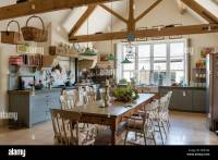 Vintage farmhouse table in rustic kitchen with green ...