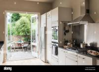 French windows open onto garden from kitchen area with