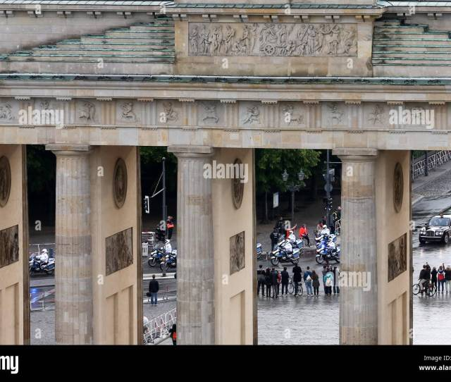 Berlin Germany Rd June  A Police Motorcade Escorts British Queen Elizabeth Ii And Her Husband Prince Philip Toward The Brandenburg Gate In Berlin