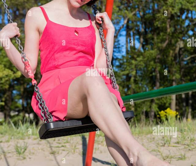 Petite Brunette Swinging On The Sandy Beach