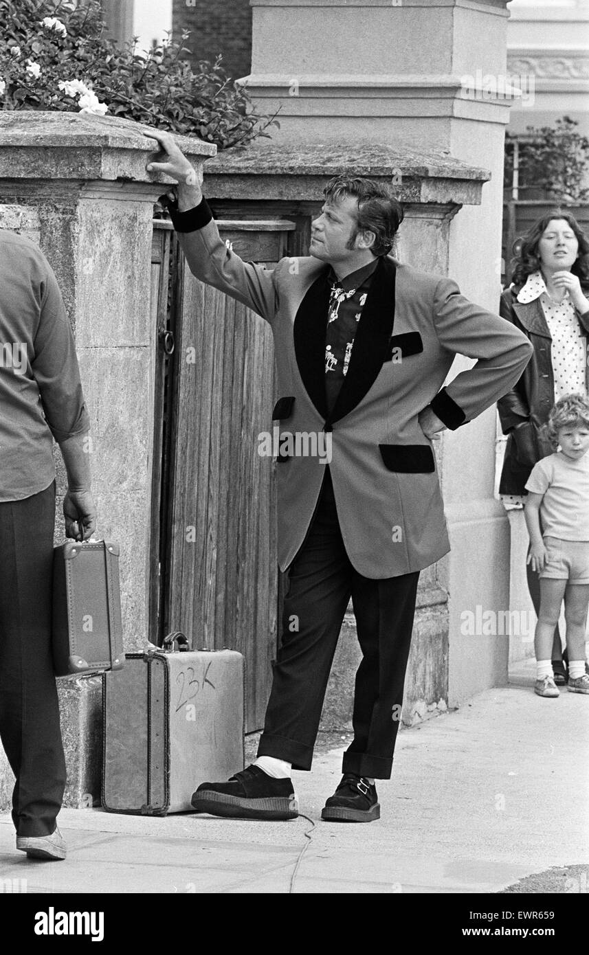 Actor Oliver Reed dressed in Teddy Boy clothing during a
