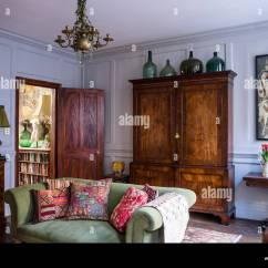 Green Cushions Living Room How To Decorate Modern Home Stock Photos Images Indian And Antique French On Sofa In With Large Armoire