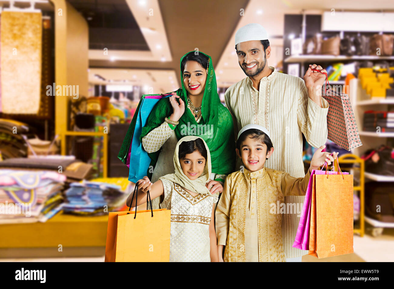 indian Muslim Parents and kids mall shopping Stock Photo - Alamy