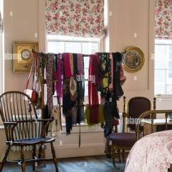 Bedroom Chair For Clothes Baby And Table Assorted Scarves Hung On A Chinese Rack In With Floral Patterned Blinds Windsor