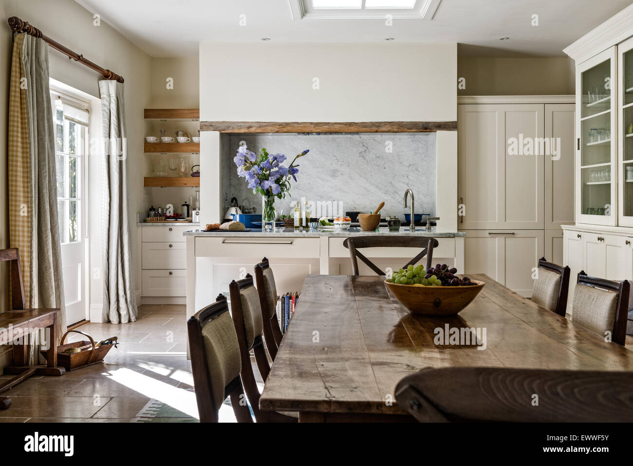 antique kitchen table cheap hotels in negril with dining chairs open plan room limestone flooring