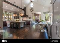 Large, rustic contemporary kitchen with wood-beamed ...