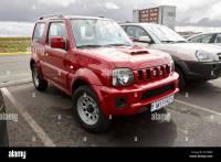 red suzuki jimny jeep hire car at keflavik airport iceland ...