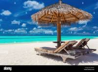 Two chairs and umbrella on a tropical beach with amazing ...