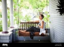 Woman Sitting On Porch Swing