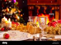 A romantic Christmas dinner table setting with candles and ...