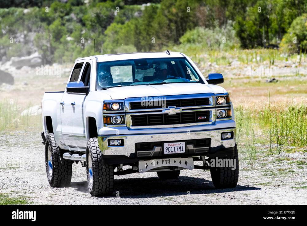 medium resolution of a 2014 chevy silverado z71 four wheel drive truck with custom raised suspension tires and wheels at grant lake in june lake ca