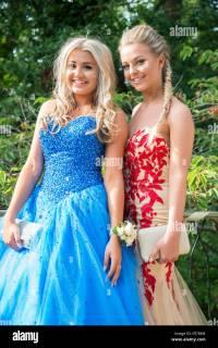 Teenage girls posing in prom dresses, Englefield Green ...